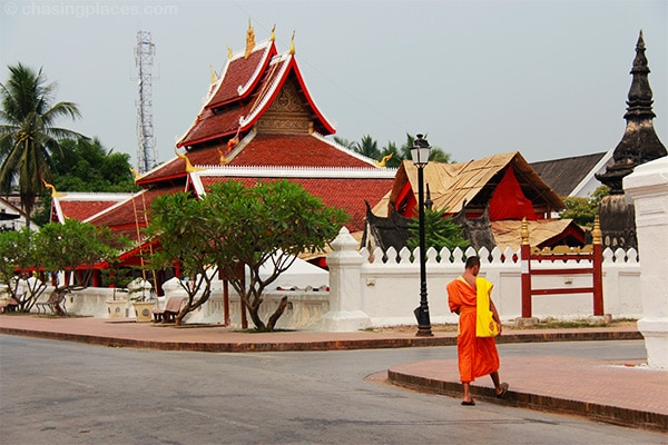 A monk walking quietly down the street in Luang Prabang, Laos