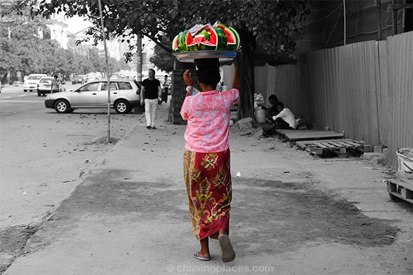 This beautifully dressed women moves briskly in the scorching sun to sell off her mouthwatering watermelon as quickly as possible. It tasted as good as it looks.