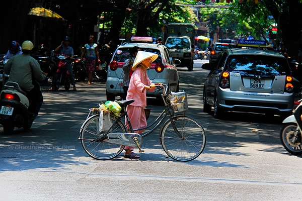 Vietnamese women still love their traditional bicycle.