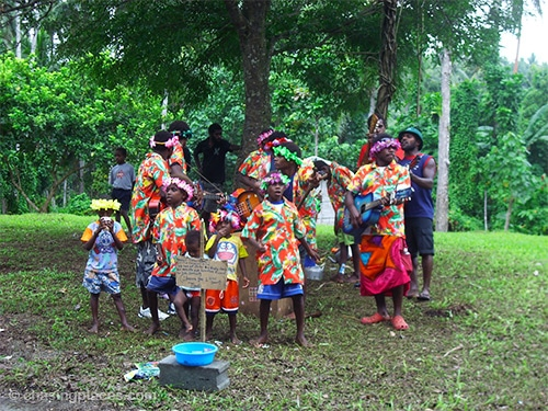 A local performing group welcoming cruise ship passengers to Pentecost Island.