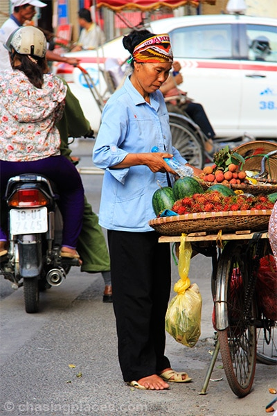 Fruit vendor in the Old Quarters of Hanoi