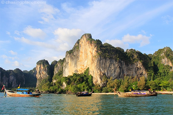 Longtail boat waiting at jaw dropping Railay West Beach