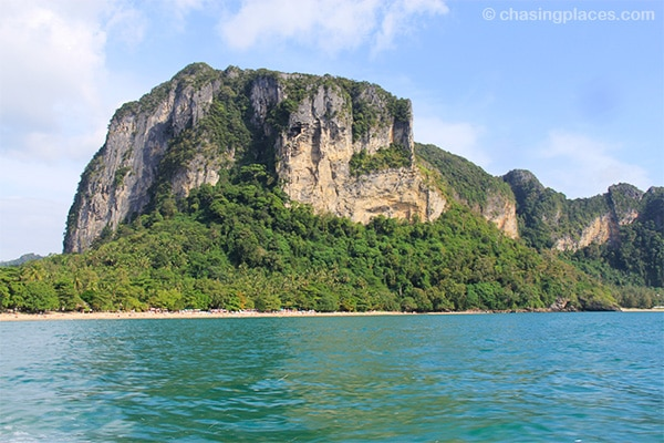 Ao Nang Beach transforming from golden sand to a stunning limestone face.