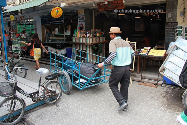 Luggage porter travelling through a narrow street on Koh Phi Phi Don