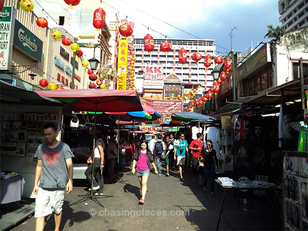 Shoppers navigating through the pedestrian traffic in Petaling Street (China Town)