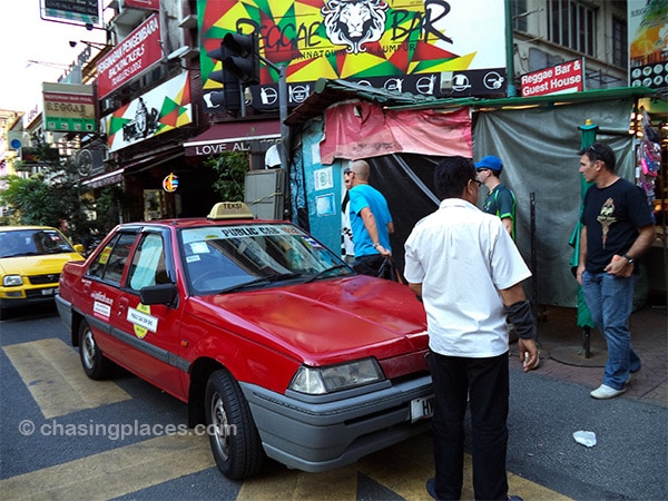 Taxi drivers tend to stay as close as possible to the entrance of Petaling Steet to secure rides with tourists