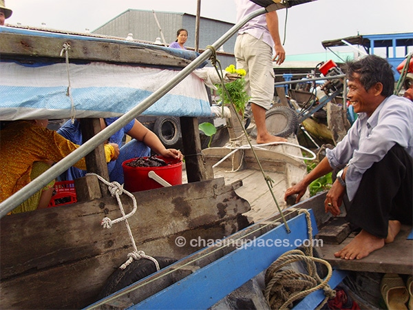 Locals having a laugh at the floating market near Can Tho, Vietnam