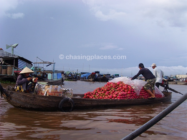 Some of the locals on the Mekong transporting a massive pile dragonfruit with rain looming in the background