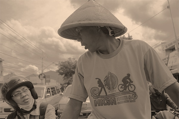Our becak driver chats with a moto driver at a red light in Yogyakarta
