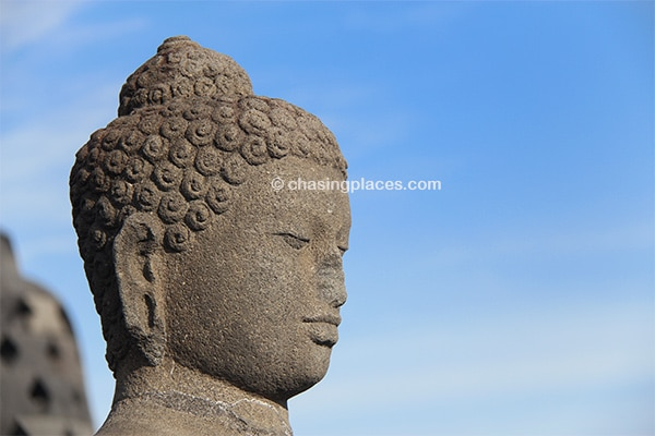 Be amazed by the statues at Borobudur