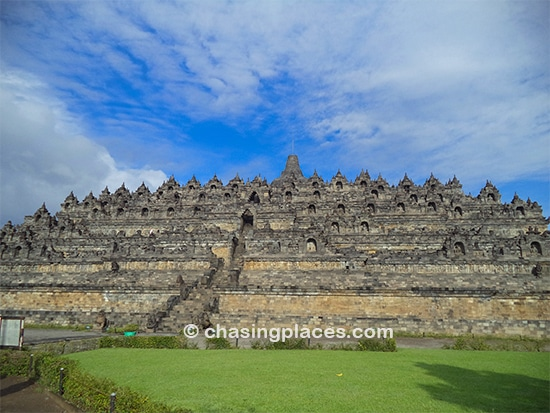 Unless you have a super wide angle camera lens good luck getting massive Borobudur in one shot.