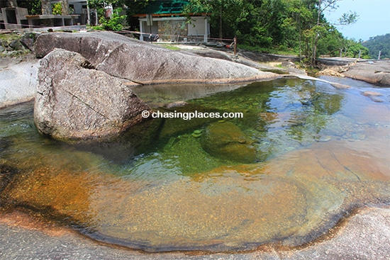 One of the clear pools making up the Seven Wells Waterfalls Langkawi