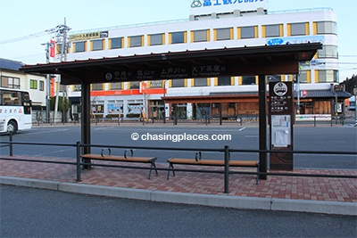 Bus platform #5 in front of Kawaguchiko Train Station . The bus goes from here to Kofu Station