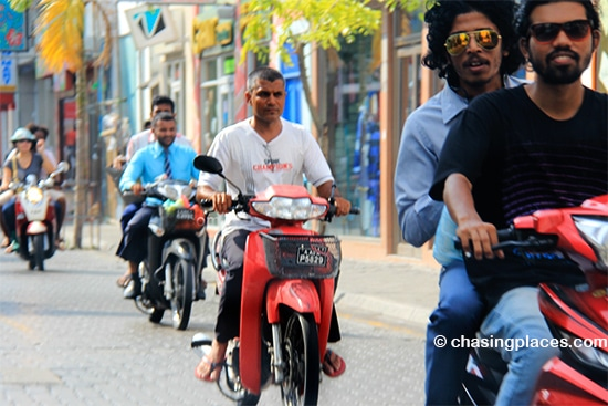 Some local Maldivians whisking by on the streets of Male