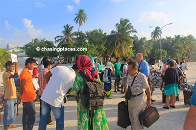 The guesthouse and hotel staff on Maafushi greeting tourists at the ferry upon arrival
