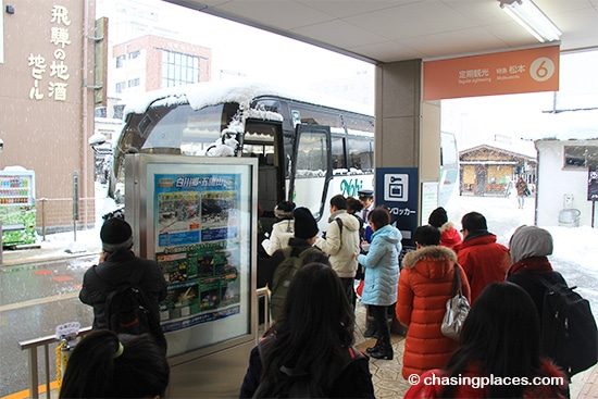 Boarding the tour bus at Takayama Station