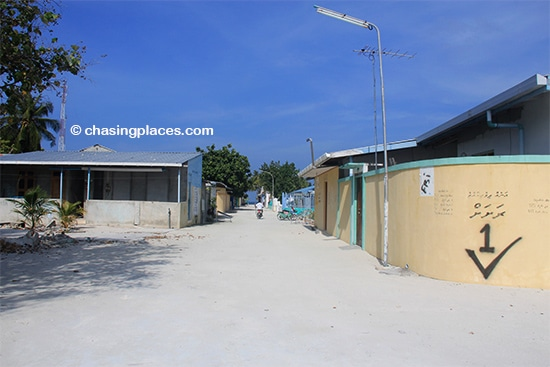 Curved cement walls surround many of the homes on Maafushi Island