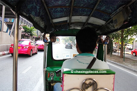 Take a Tuk Tuk to Ratchathewi Station in order to catch the Skytrain to Chatuchack Market