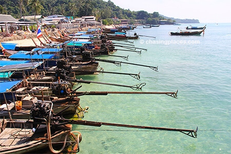 There are plenty of longtail boats waiting for passengers to go to long beach from Ton Sai Beach
