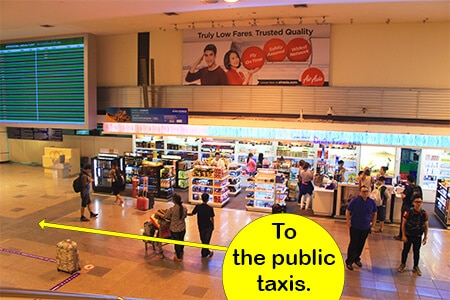 Once you head down the escalators at Don Mueang start looking for the taxi signs