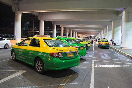 The taxis parked right outside the taxi desk at Don Mueang International Airport