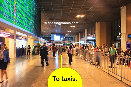 Walk past the rental car booths and tourist information desks to reach the taxi area