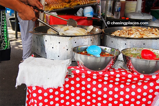 A spicy fish dish in the making at Chatuchak Market