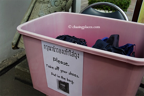 Simply place your shoes in the bag provided to carry your shoes at Wat Pho