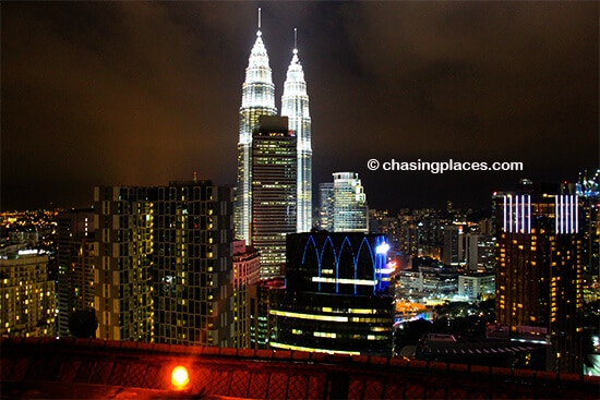 Try to find a view of the Petronas Towers from one of KlL's excellent skybars