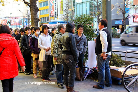 Otaku in Akihabara, awaiting an Anime poster release.