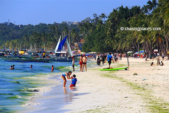 White Beach, Boracay with some green algae washed ashore.