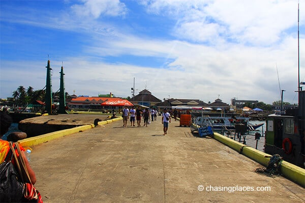 If you walk straight ahead you will reach the caticlan ferry office from there take a shuttle to Kalibo Airport