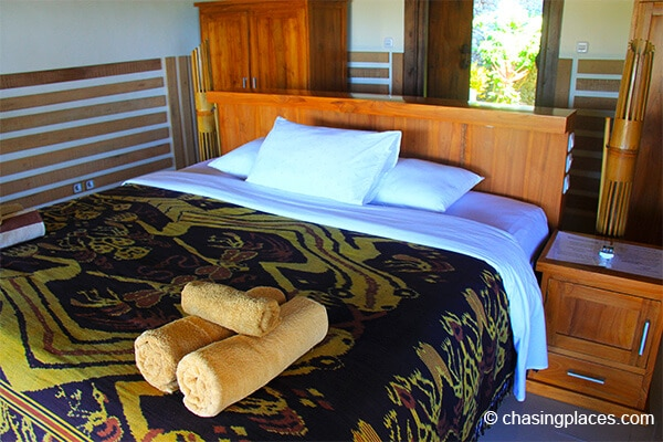 The bedding and beautiful woodworking at Rinjani Lodge
